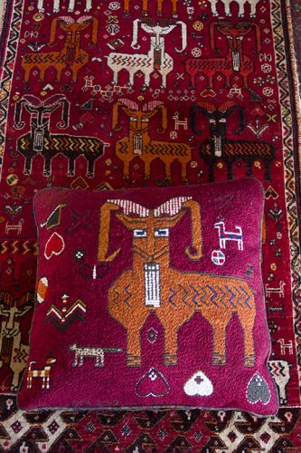 Goat Pillow Completed, resting on the Qasq'ai Persian carpet